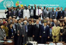 Group photo of delegates at the end of the meeting, courtesy ISA.