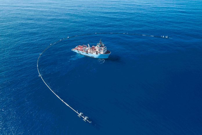 The Maersk Launcher, DeepGreen's support ship. with the Ocean Cleanup System 001.