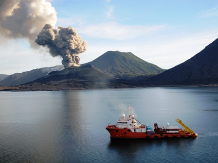 The MV Nor Sky, a vessel chartered in 2008 by Nautilus Minerals to conduct environmental assessment at Solwara I, steams past the Tavurvur volcano near Rabaul.