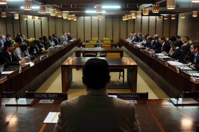 Delegates gather during an informal meeting. Photo courtesy ISA.